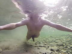 Boy swiming naked in the water